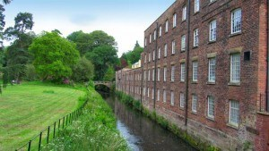 Rear view of the mill alongside the river Bollin backing onto Mill Meadow