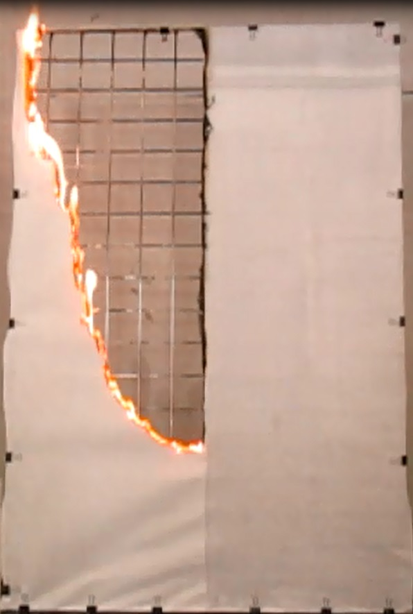 Test combustion of paper with (right) and without Landex Coat Flame Retardant Clear treatment